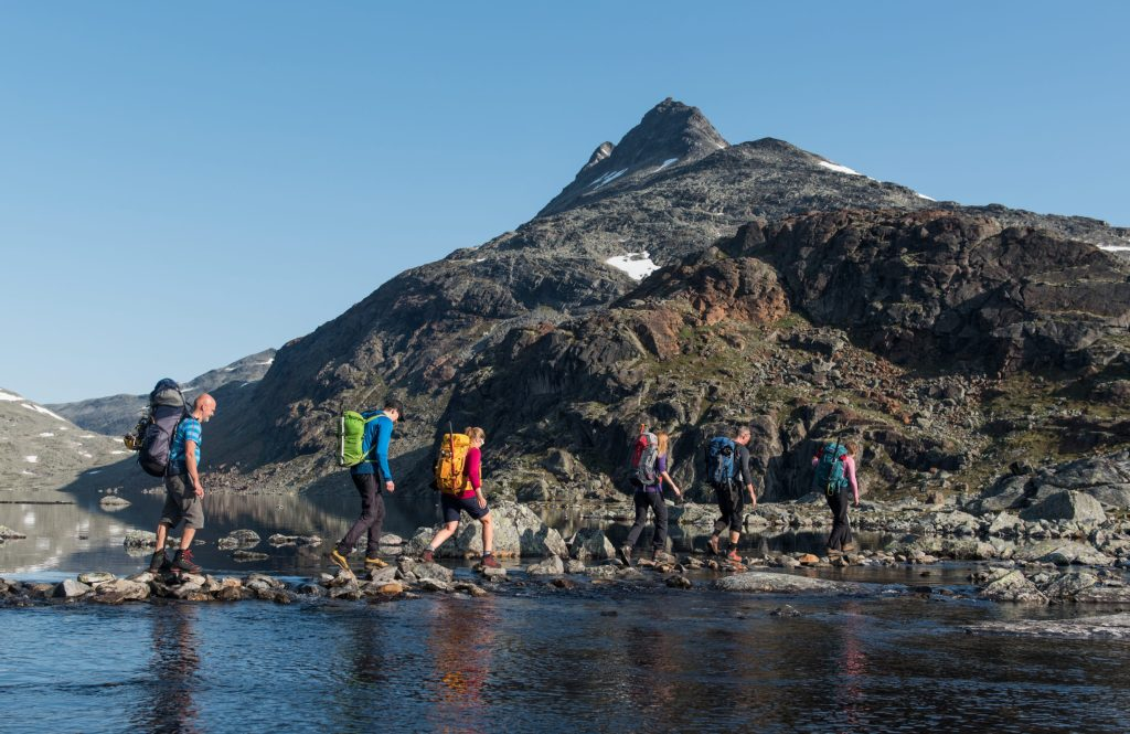 Crossing a river the peak Uranostind in the background – Yngve Ask