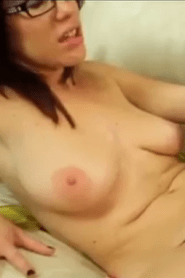 Cute redhead Jessi shedding her sexy lingerie to pose with nice tits bare