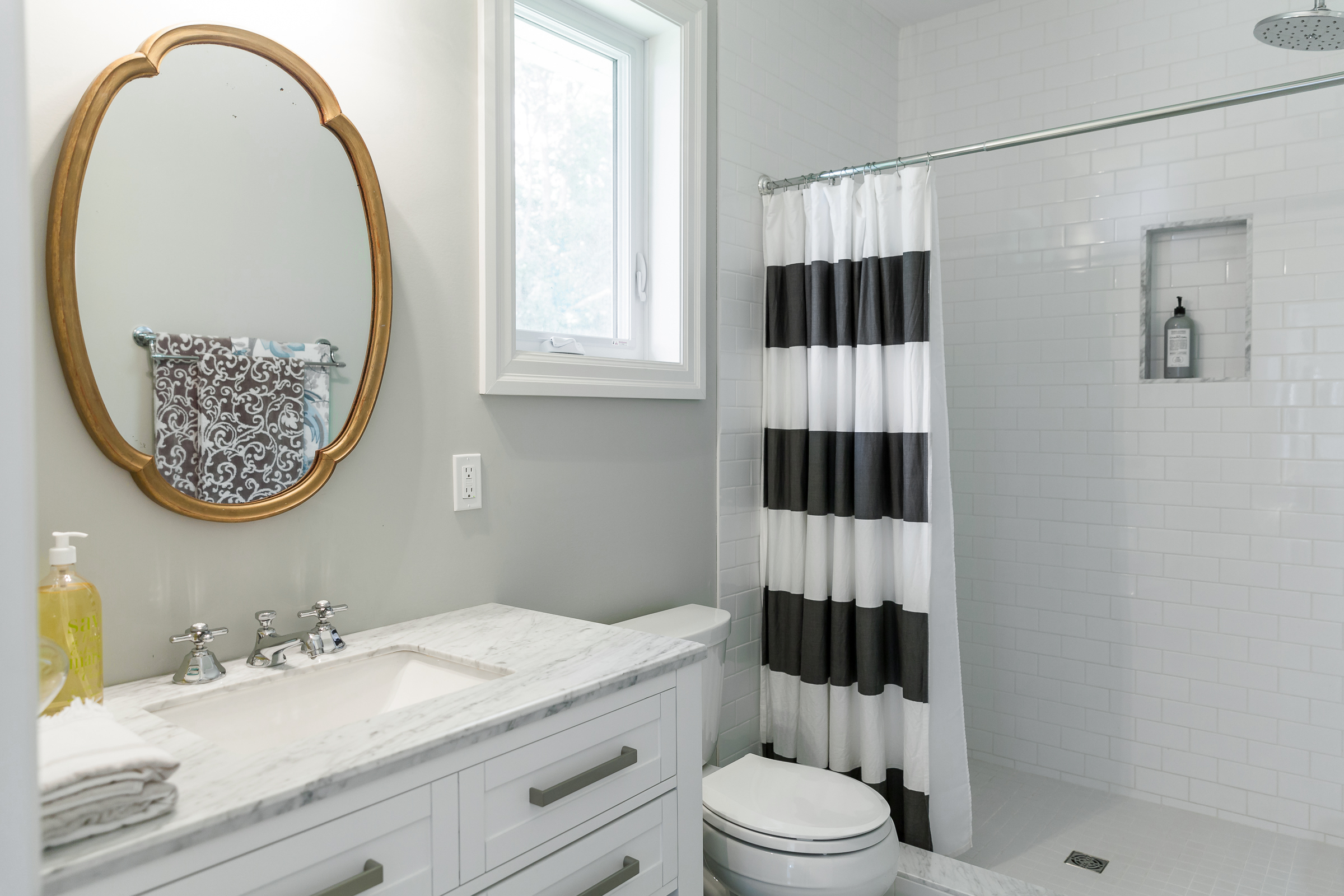 Bathroom Organizing Tip Using Two Shower Curtain Rods