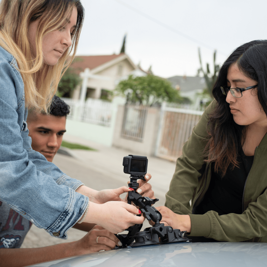 Students mount their camera before heading out to collect data.