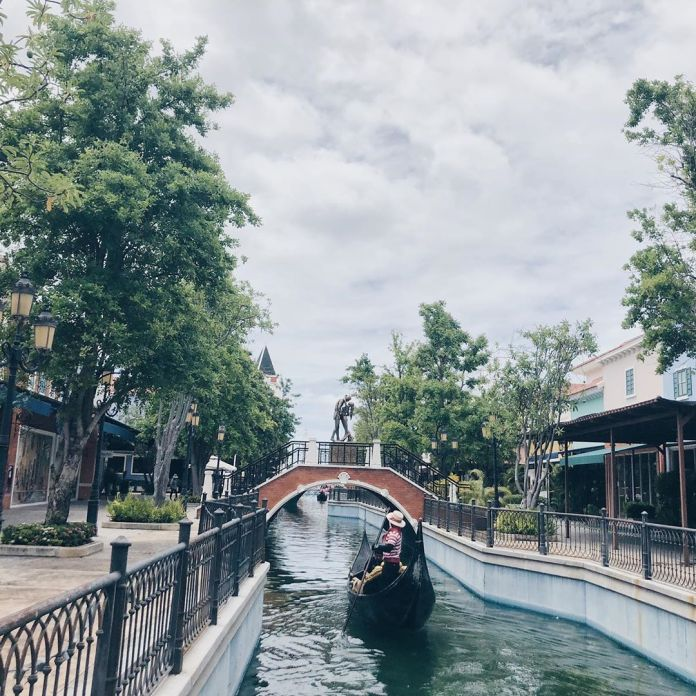 Tourist traveling along a canal