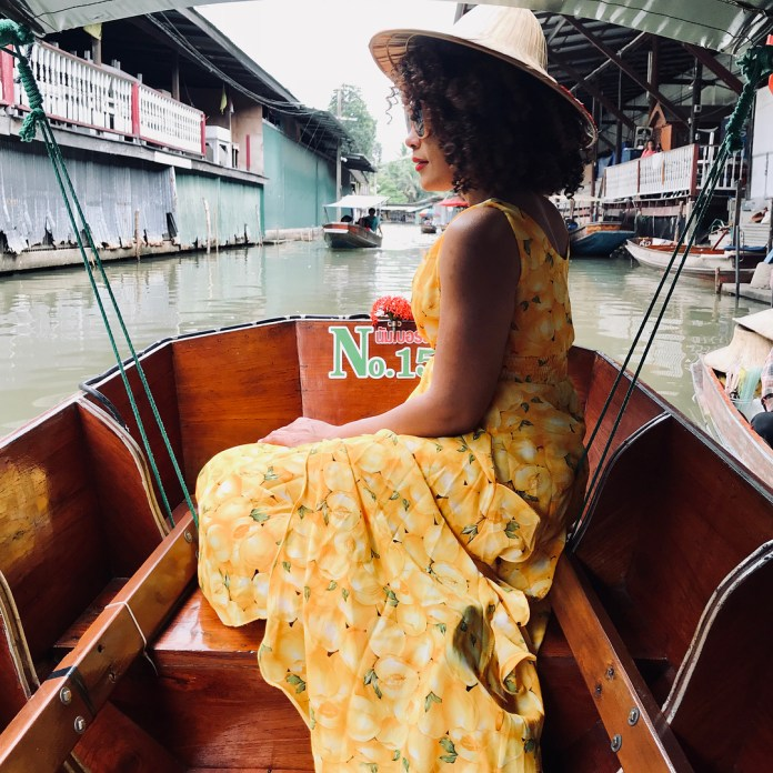 A lady posing in a boat along Damnoen saduak floating market