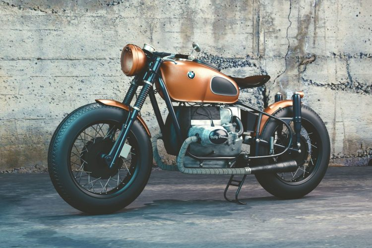 orange-and-black-bmw-motorcycle-before-concrete-wall-104842-min