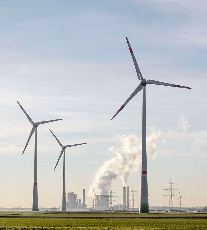 Wind Turbines at Lignite Fired Coal Power Plant Weisweiler. © Paul Langrock / Greenpeace