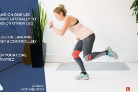 woman performs ski workout exercise - hop and stick