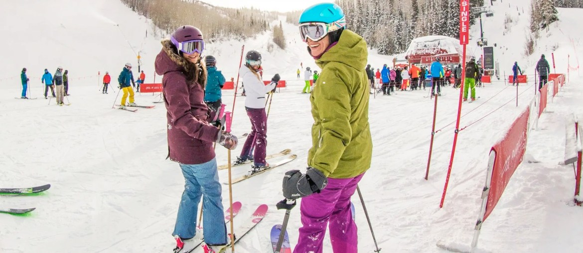 group of friends skiing look to camera