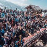 large crowd partying outdoors in the mountains at folie douce meribel
