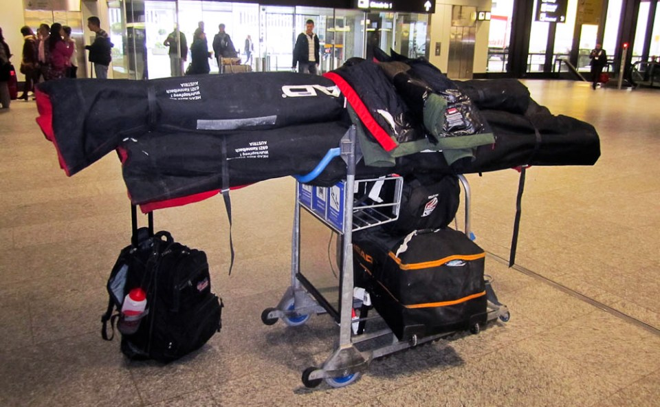 Ski bags and luggage on airport luggage trolley