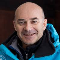 Portrait of smiling man in blue winter jacket - Bernard C - SkiBro ski instructor and mindfulness coach Val d'Isere and Tignes