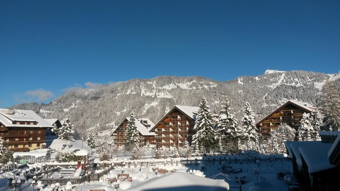 The village of Villars covered in a fresh snowfall before the start of a great day of ski lessons