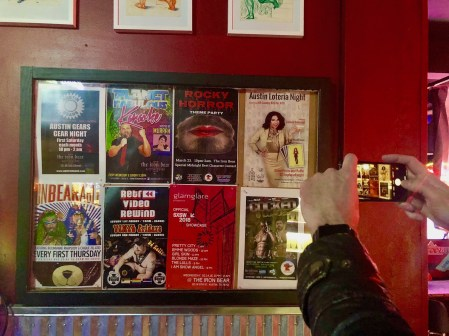 Hanging our show poster at The Iron Bear