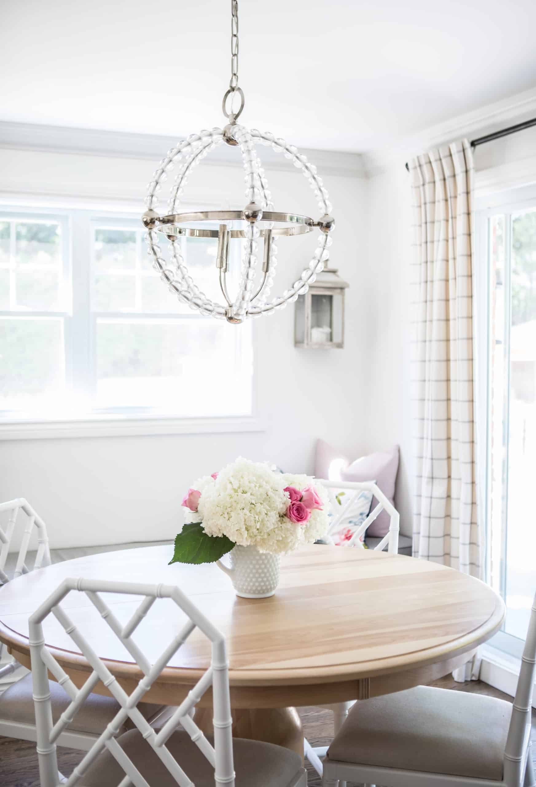 Dining room with a white spherical chandelier