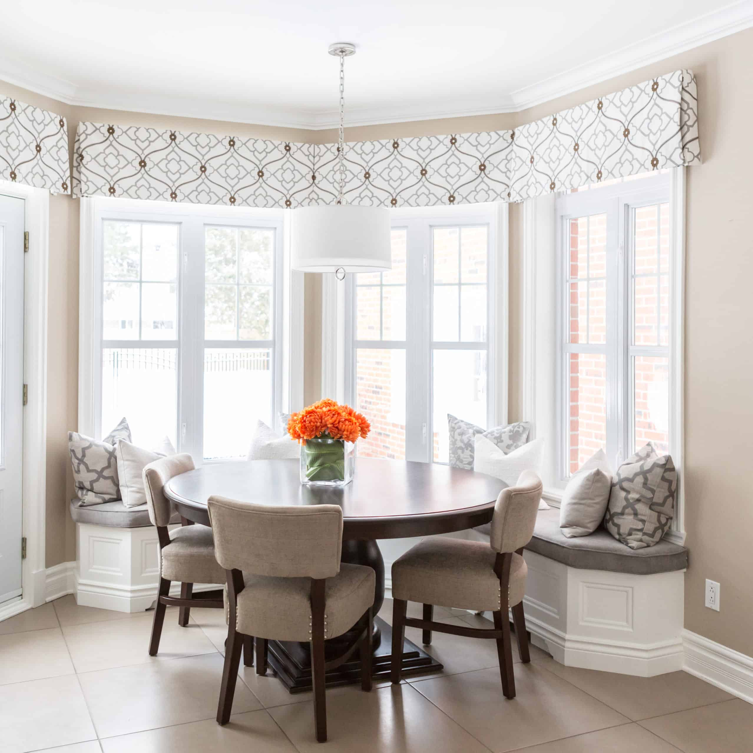 Dining room with orange flowers on the table