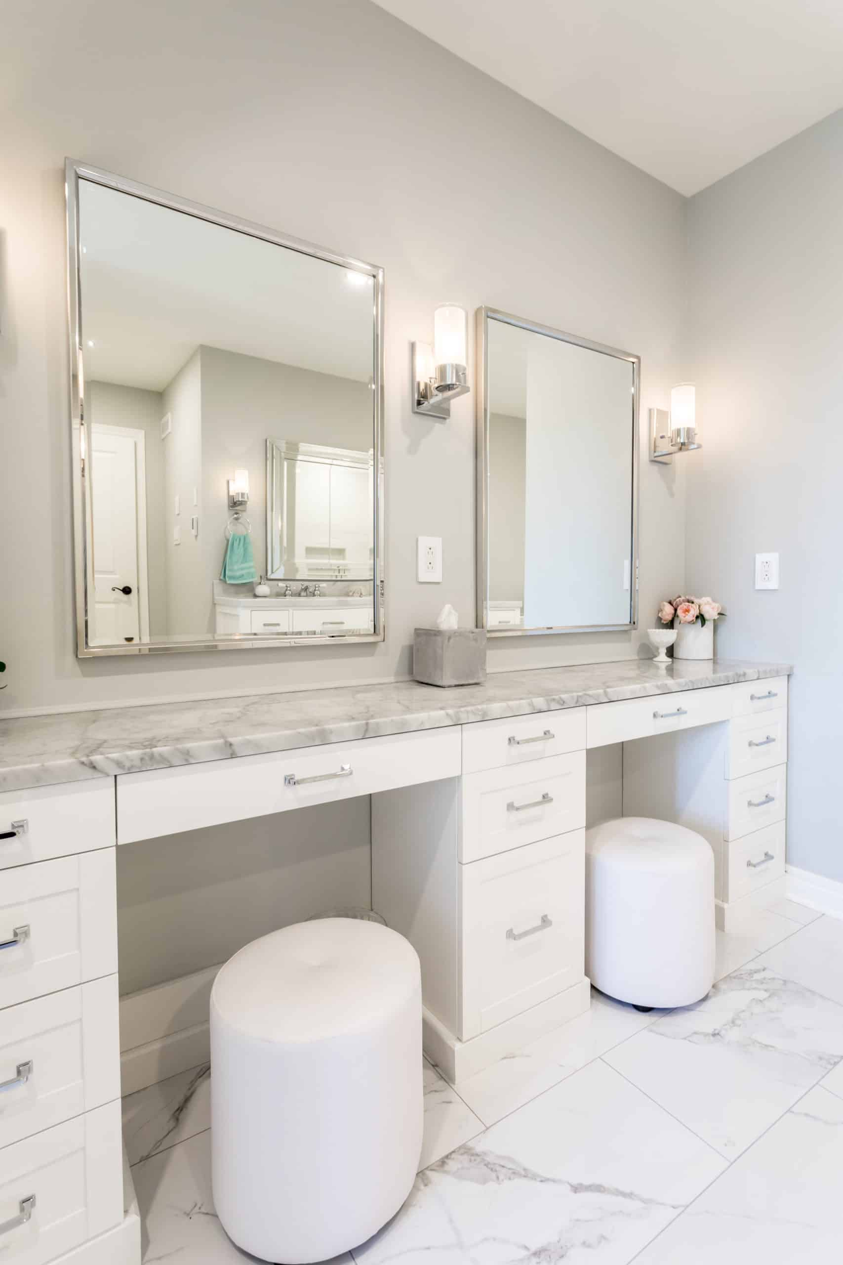 White double makeup vanity with a marble countertop