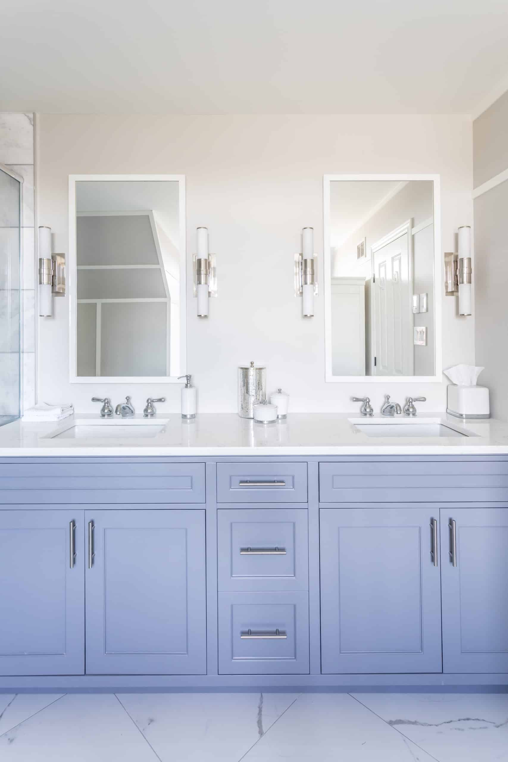 Blue double vanity with marble countertops