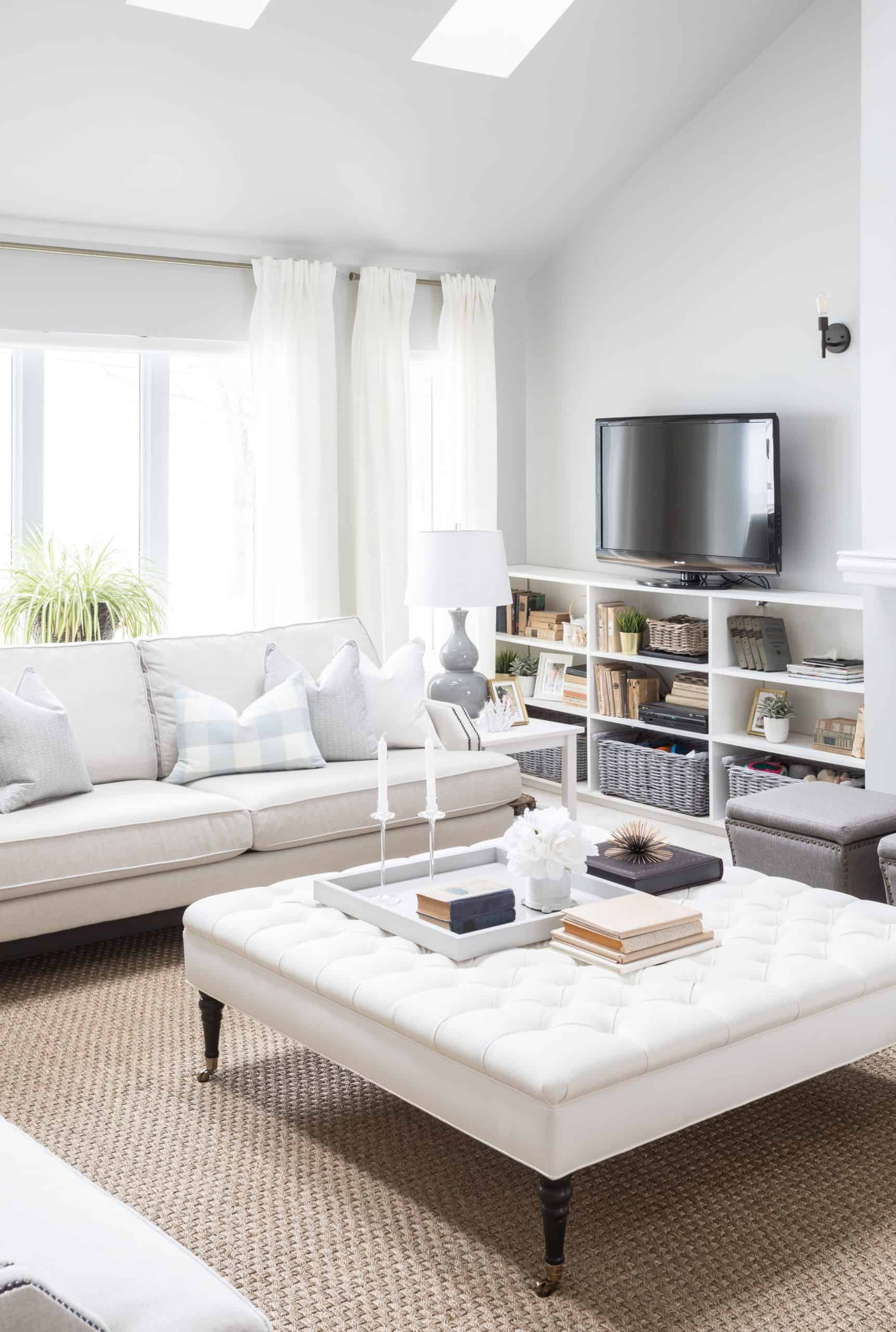 Large, bright white ottoman inside a modern living room