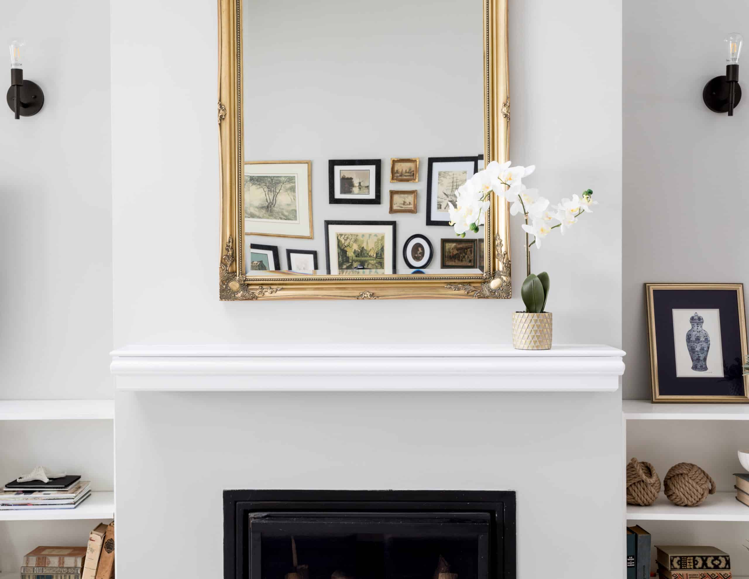 Mirror above the fireplace reflecting many pictures