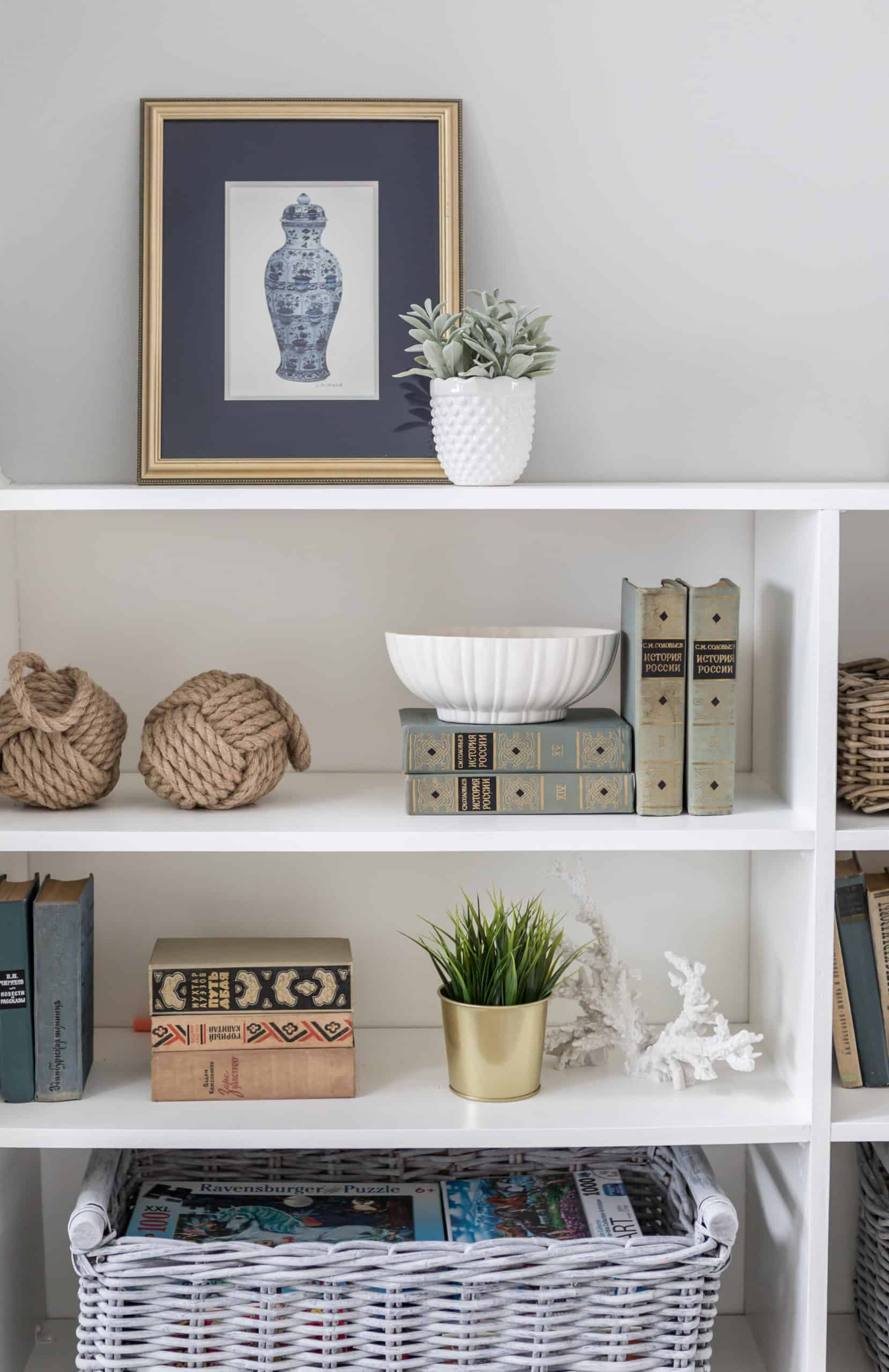 Short bookshelf with various decorations on it