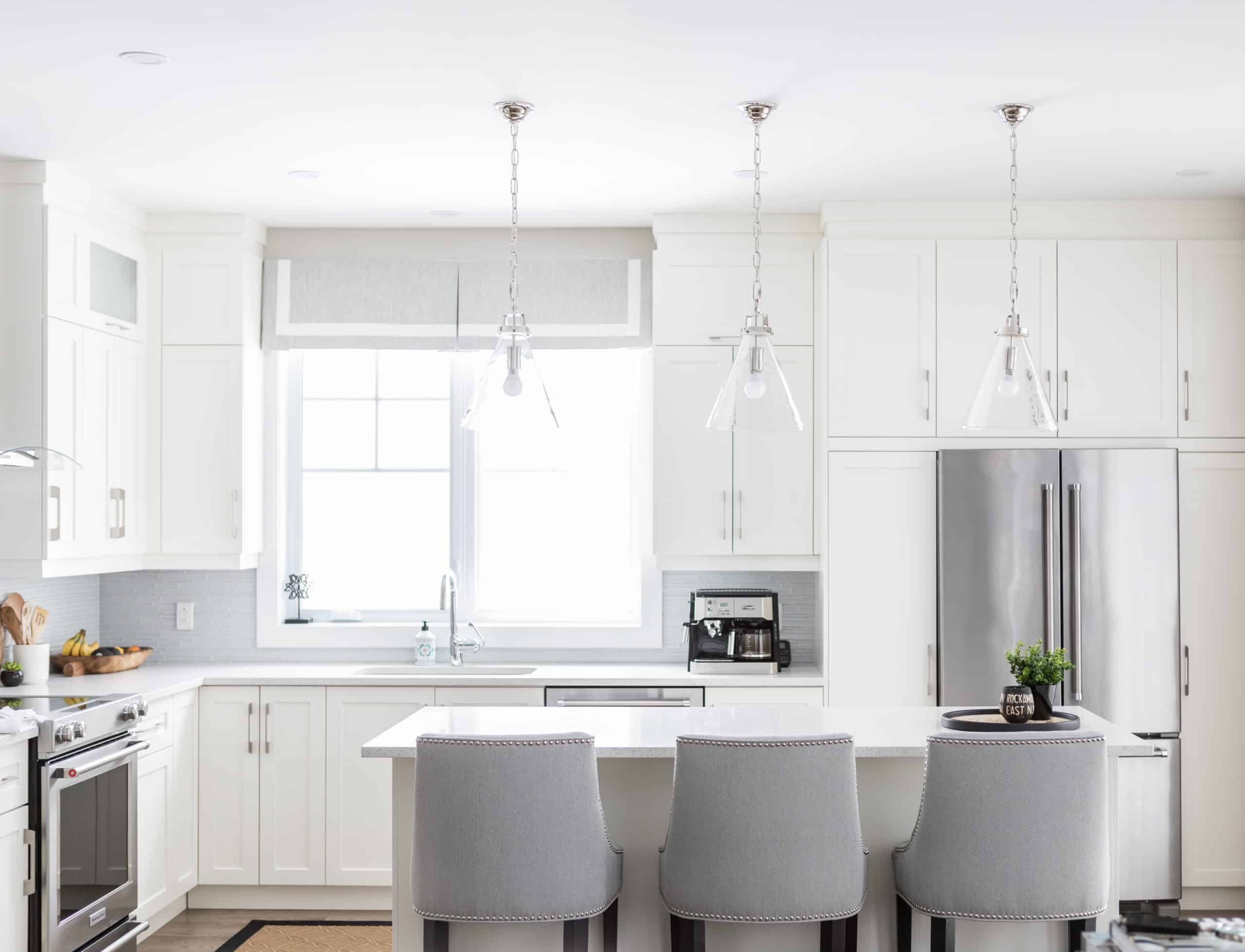Bright white kitchen with a small island