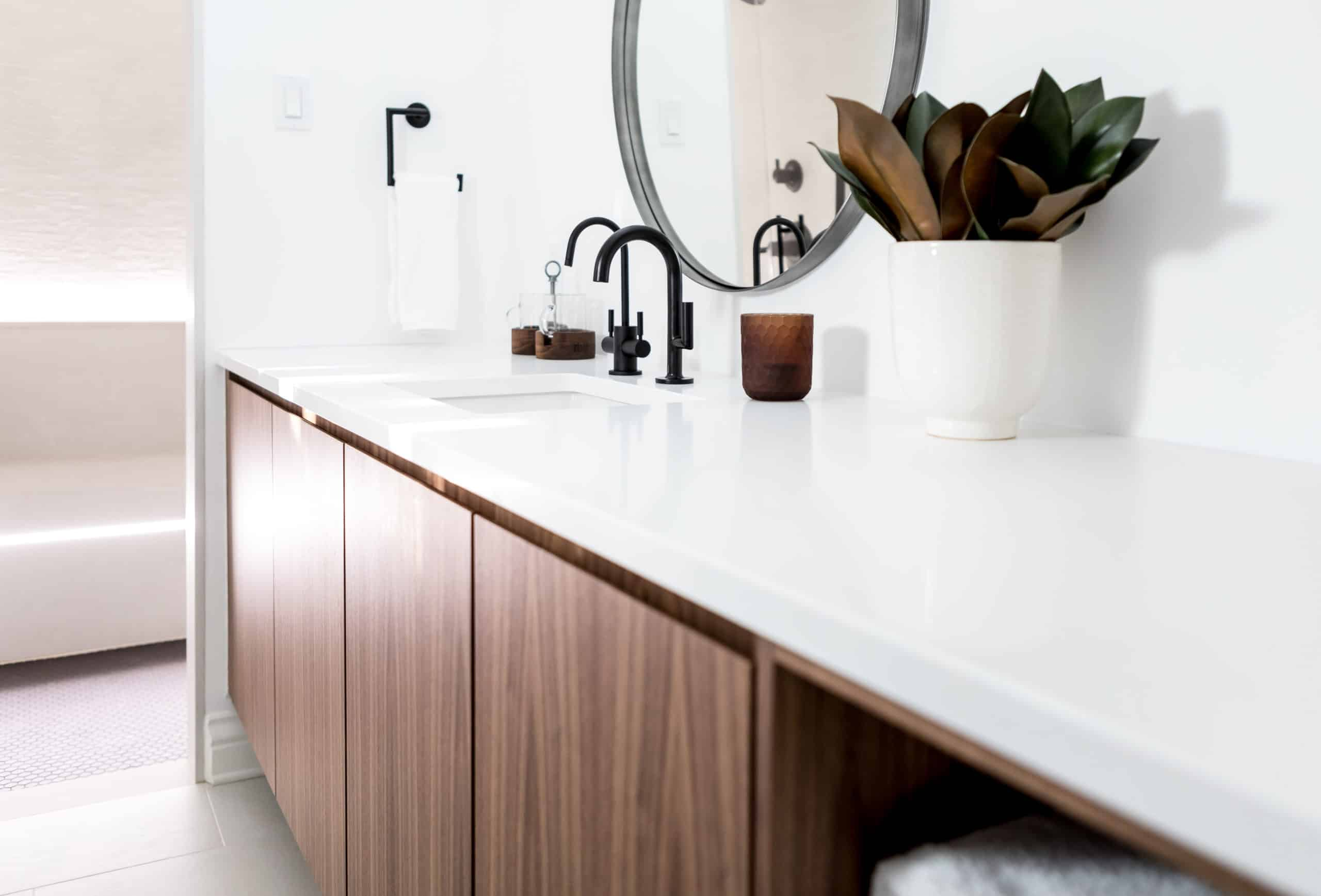 Wooden vanity with a bright white countertop
