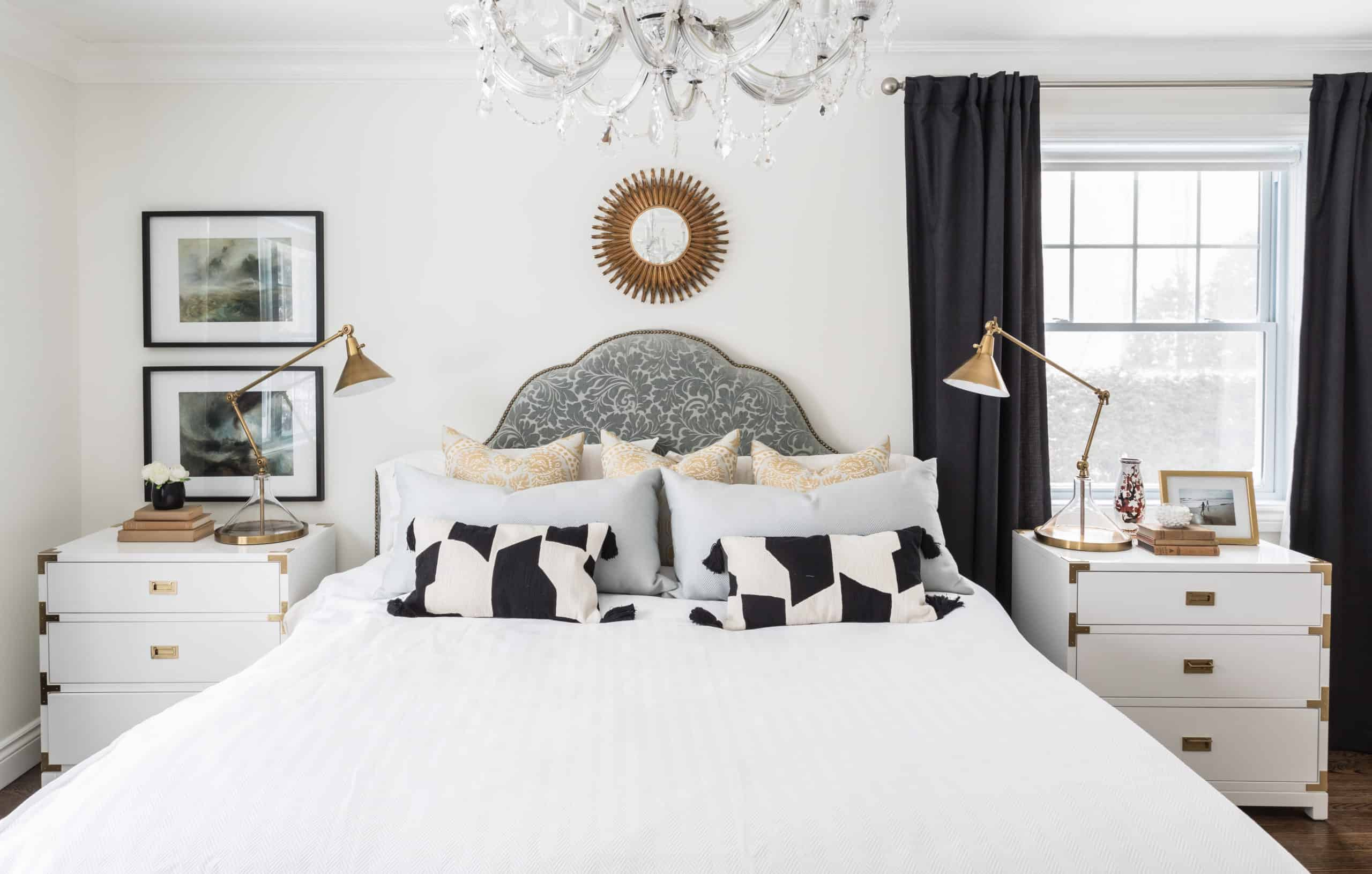 Modern master bedroom with a circular mirror decoration above the bed