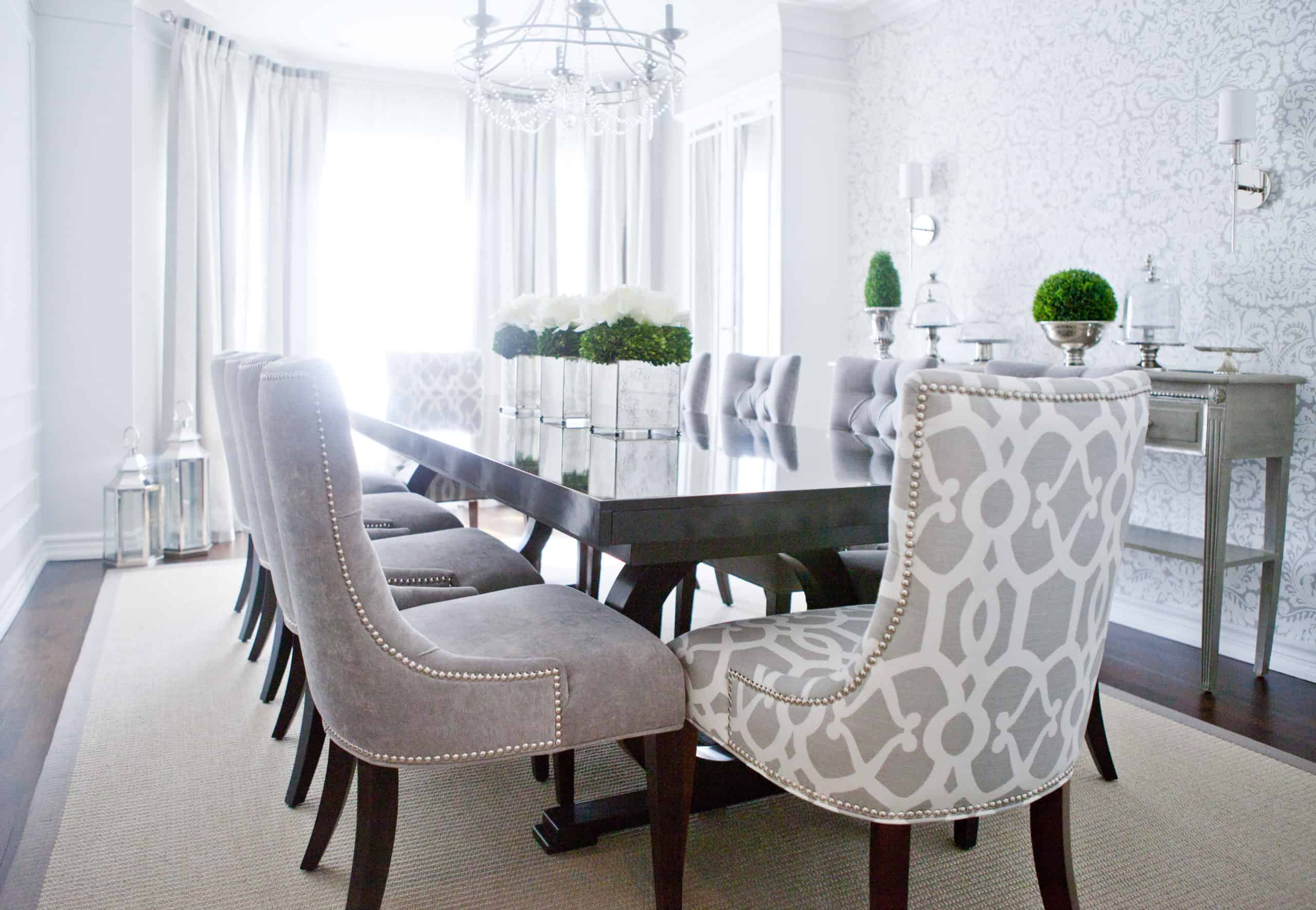 White and gray chairs at the end of the dining room table