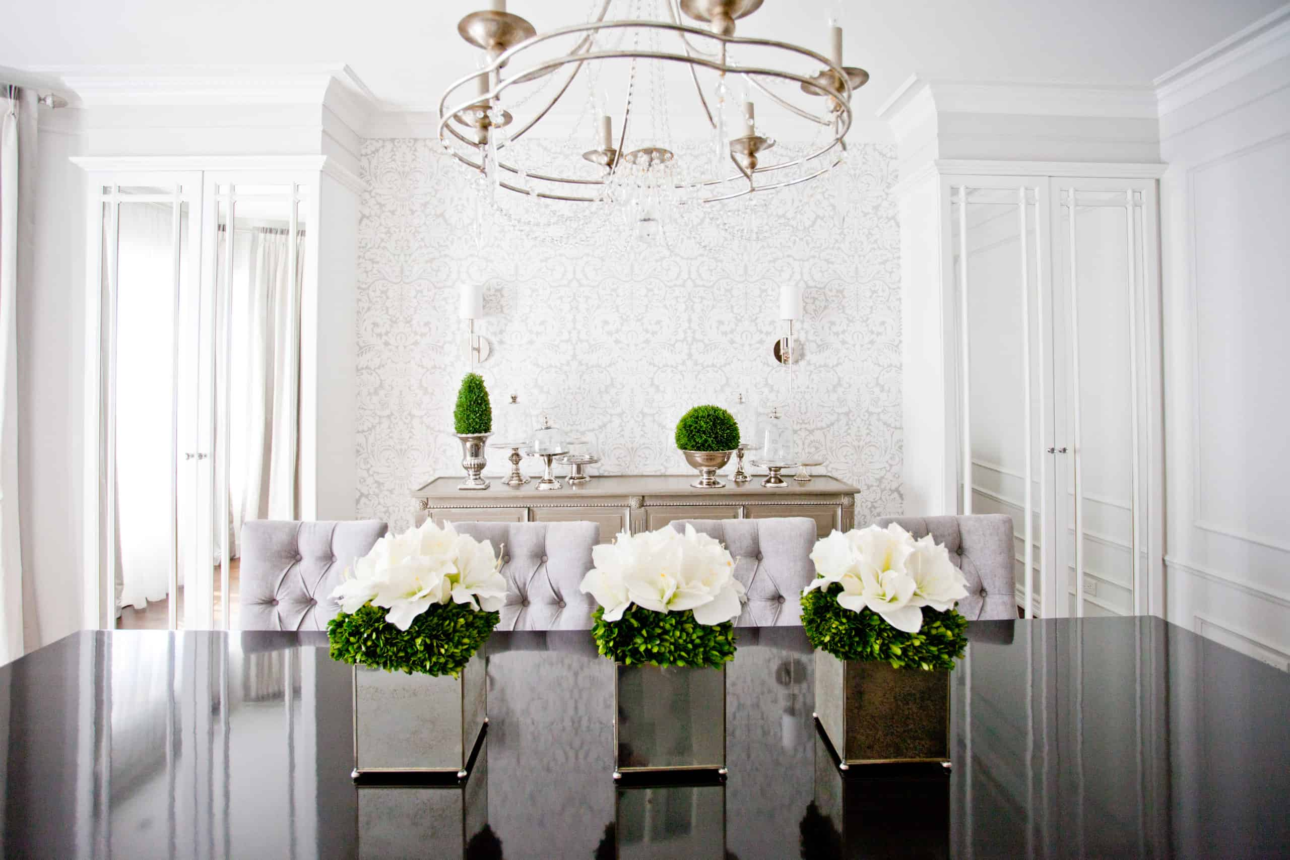 Three beautiful white flowers on the dining room table