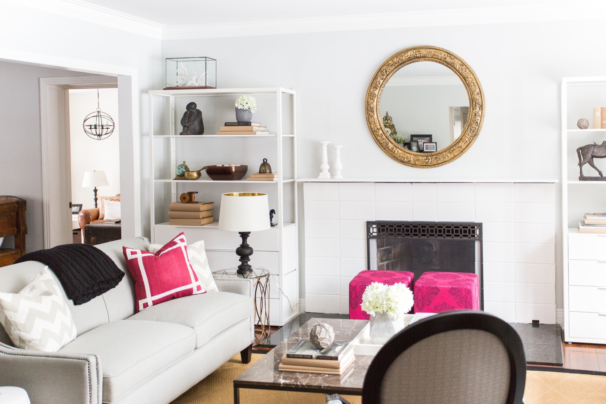 Large, open living room with pink stools next to the