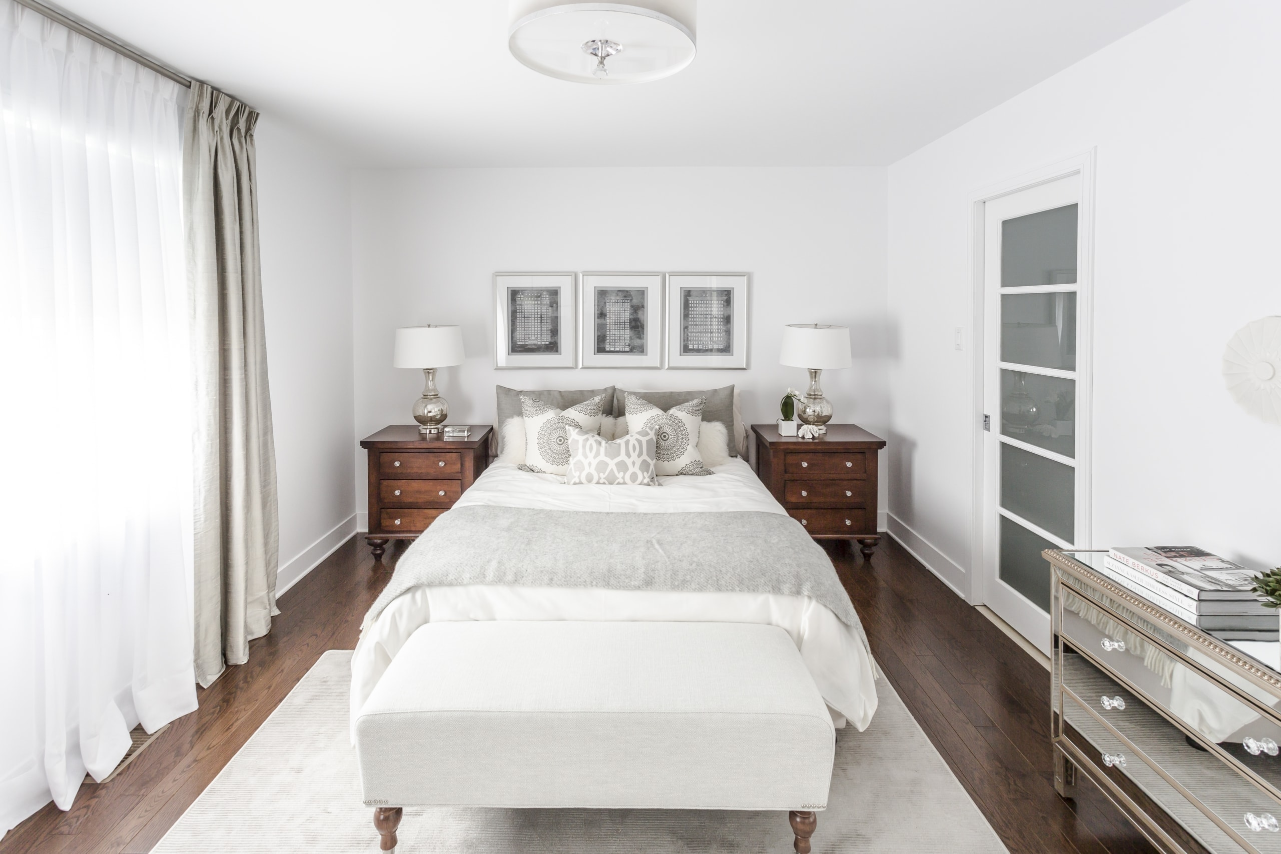 Large gray and white bed within a master bedroom