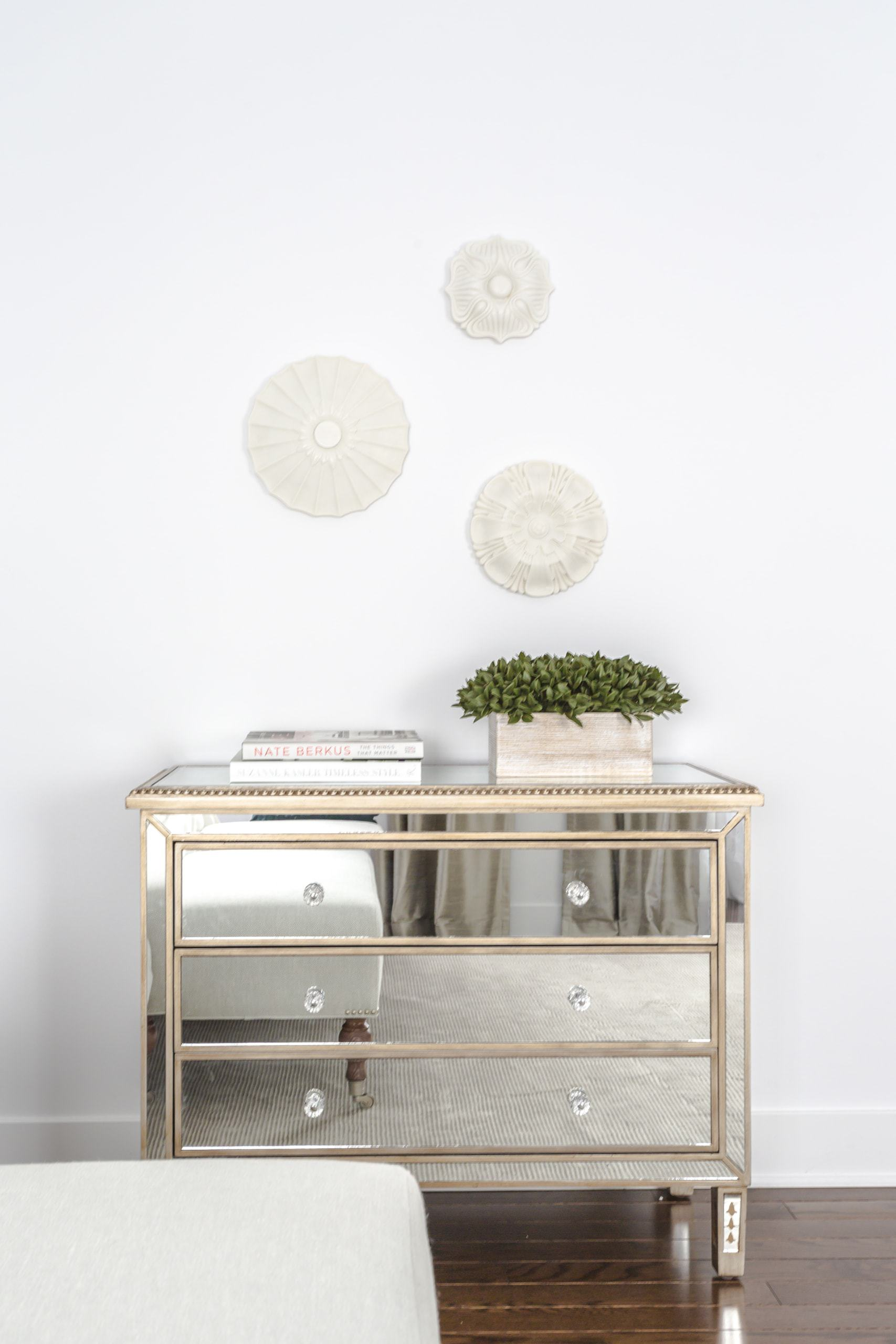 Small dresser that reflects light like a mirror
