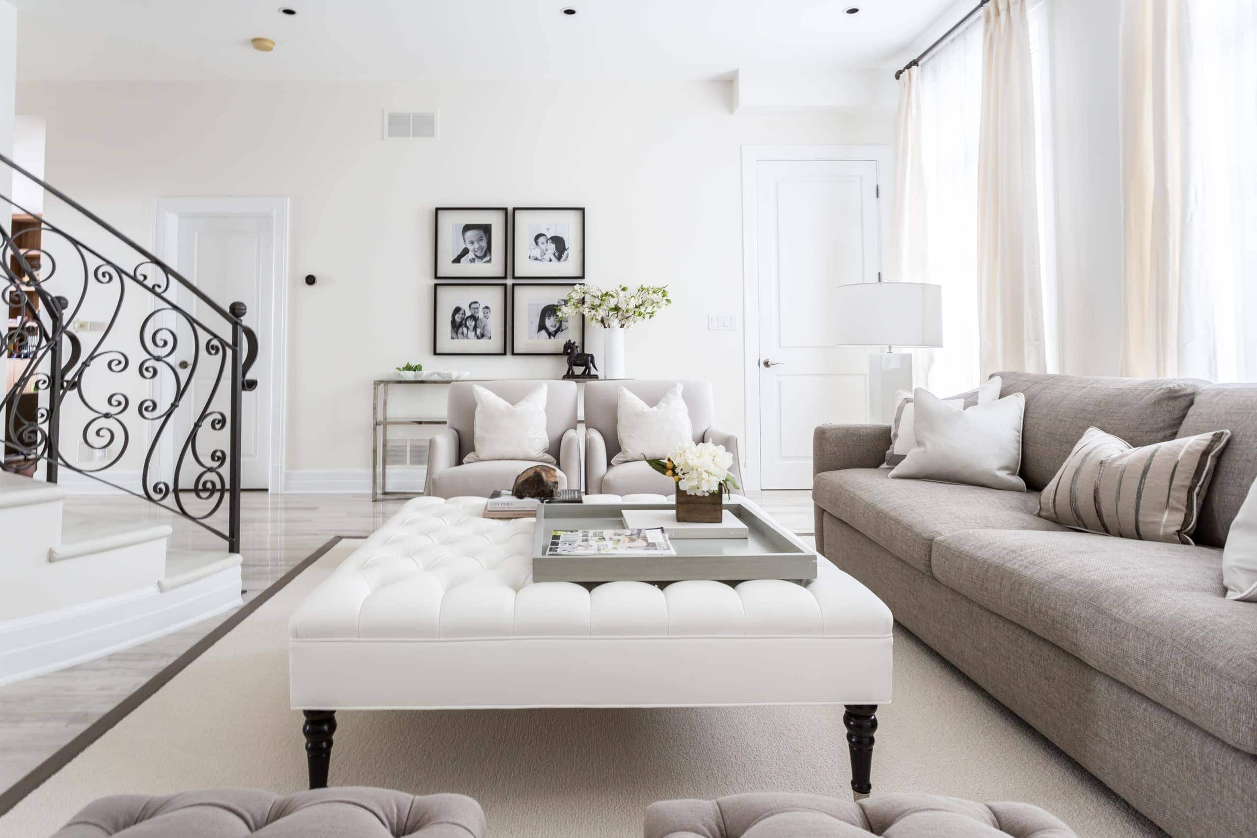 Bright living room with a focus on the large ottoman