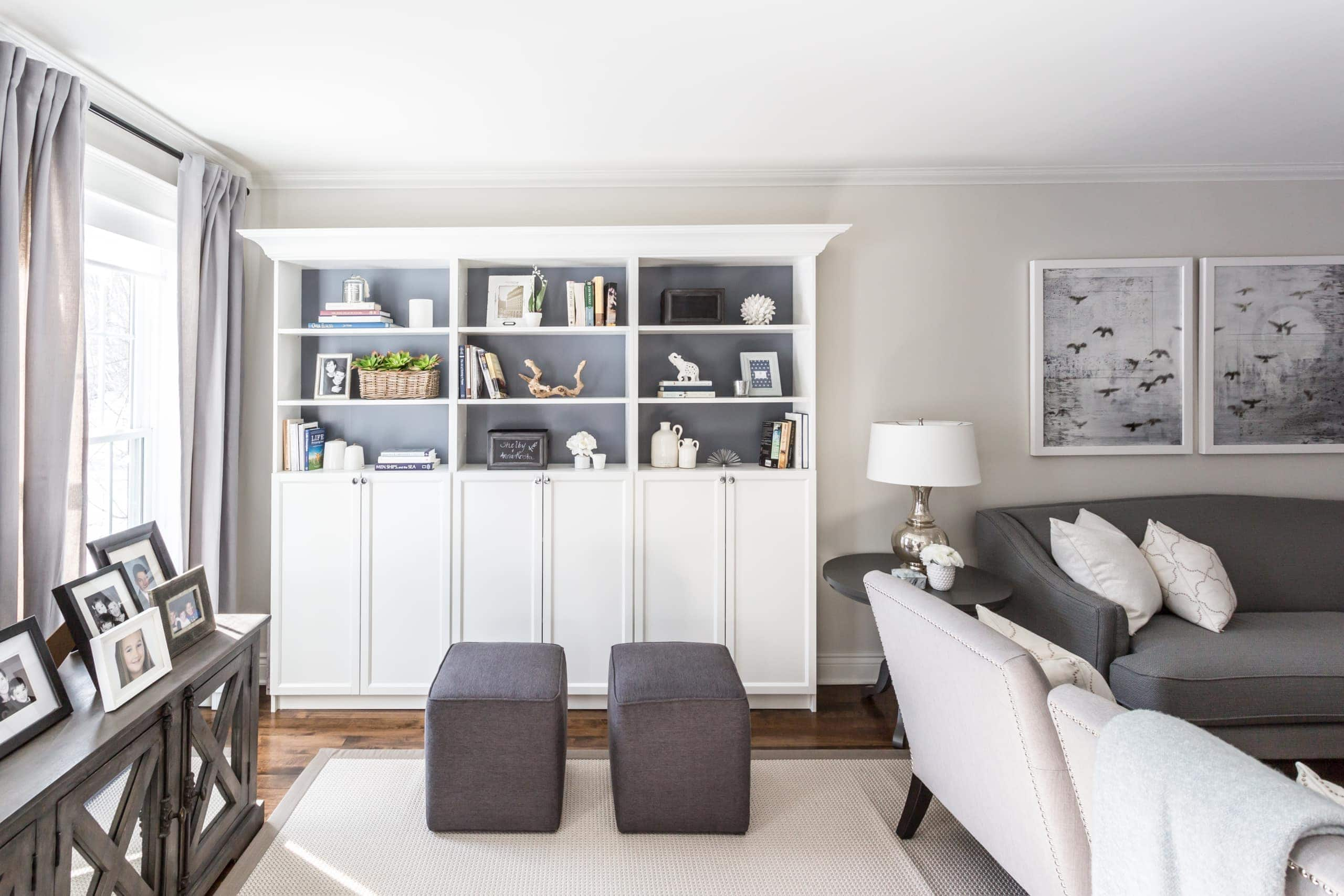 White bookcases with doors within a living room