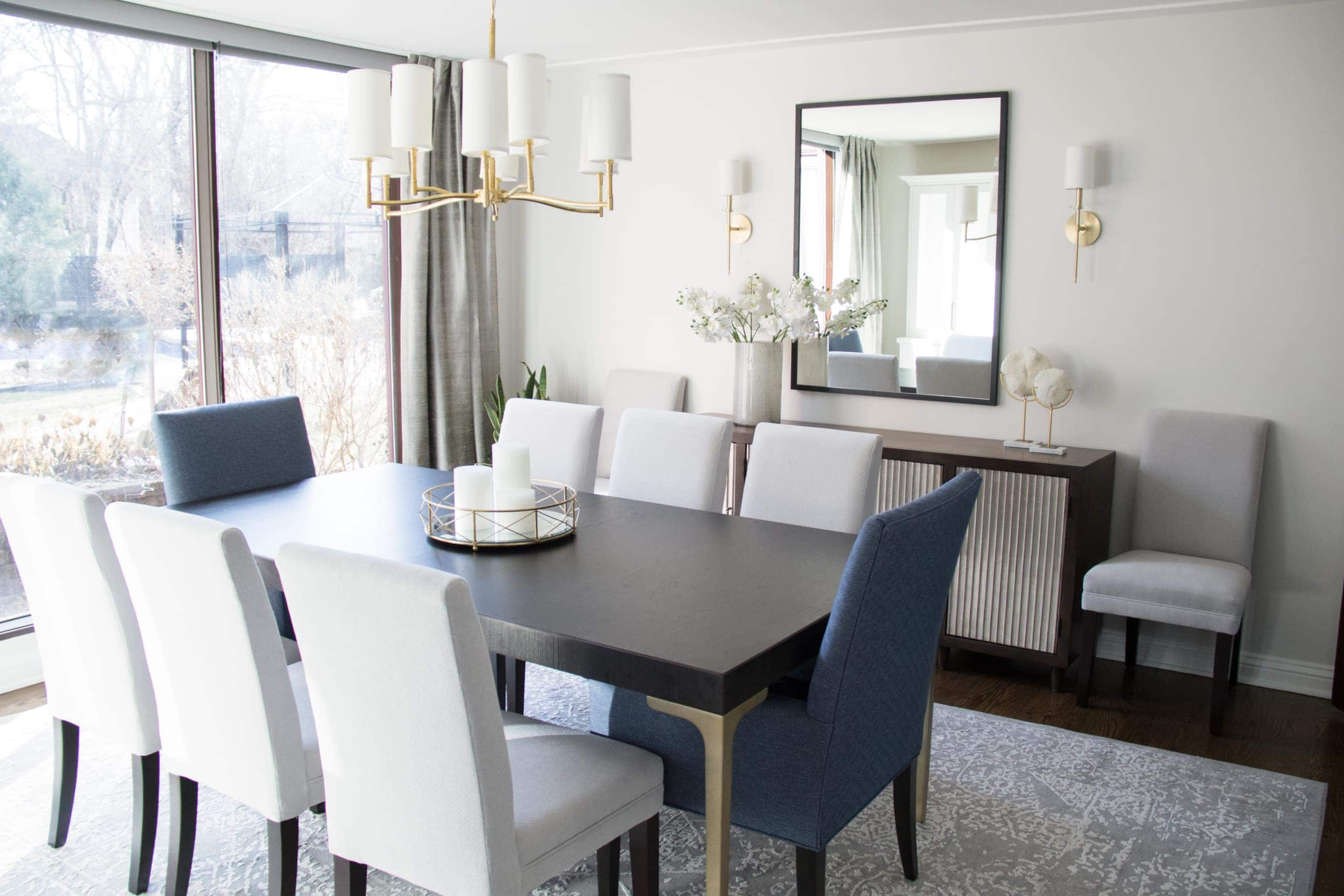 Modern dining room with blue chairs at the ends of the table