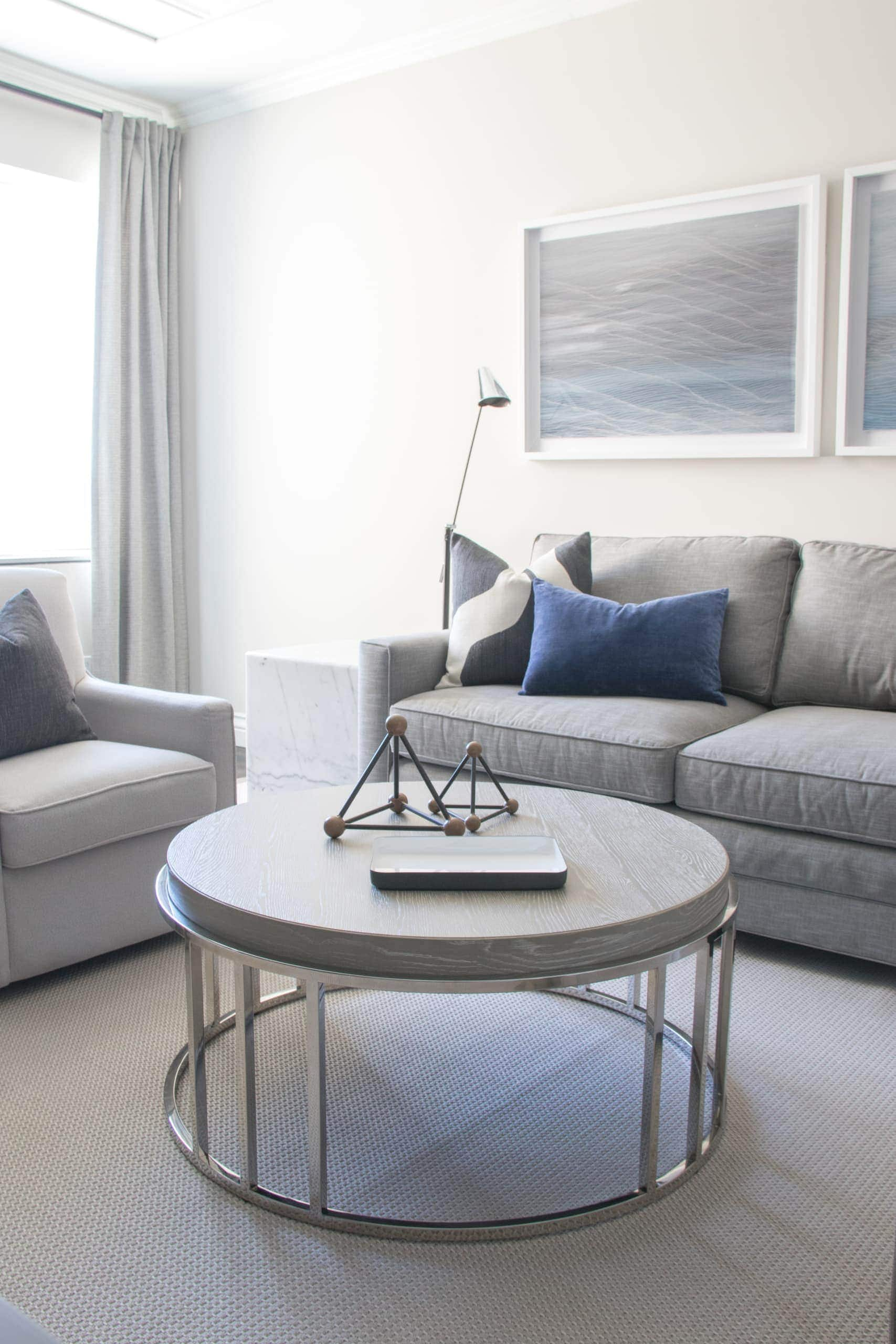 Circular, gray coffee table within a large living room