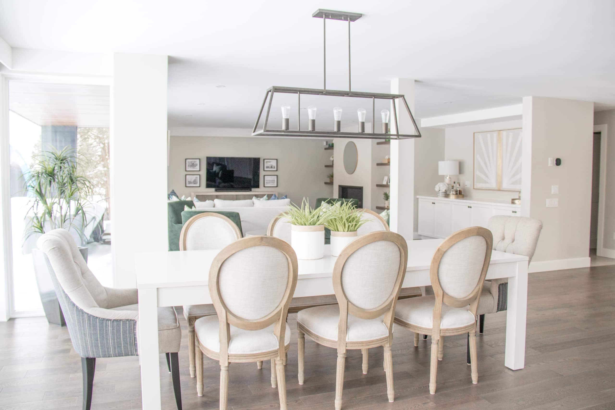 Bright, white dining room table with eight chair