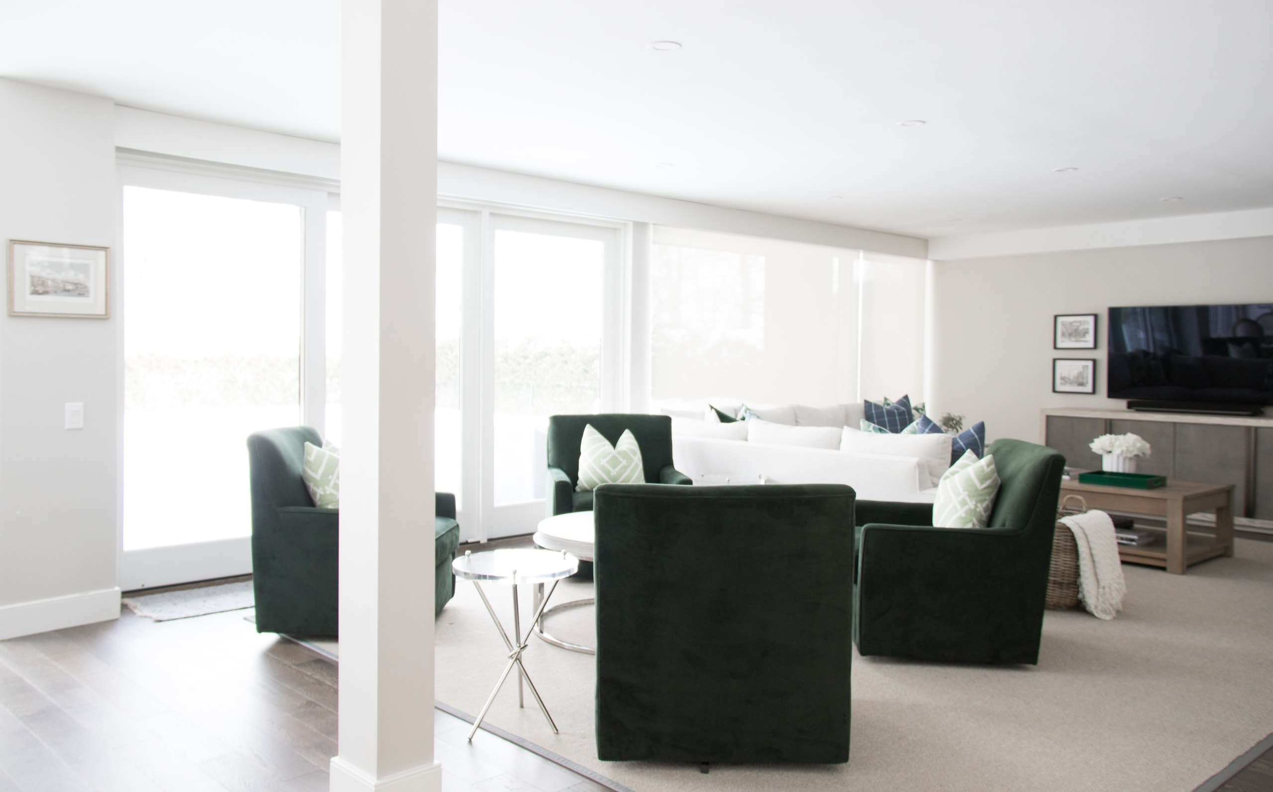 Bright, large living room with green chairs