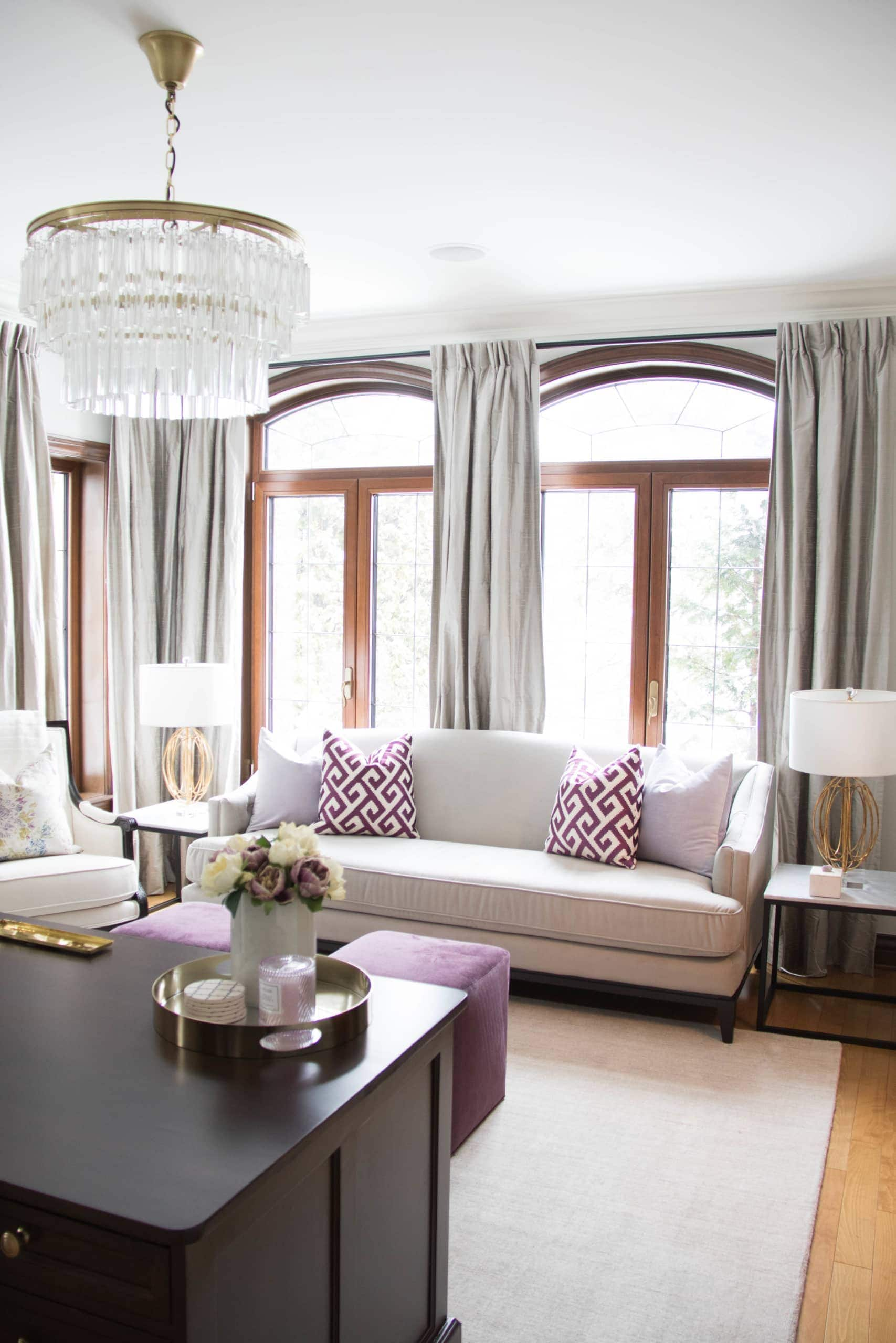 White couch against two large windows
