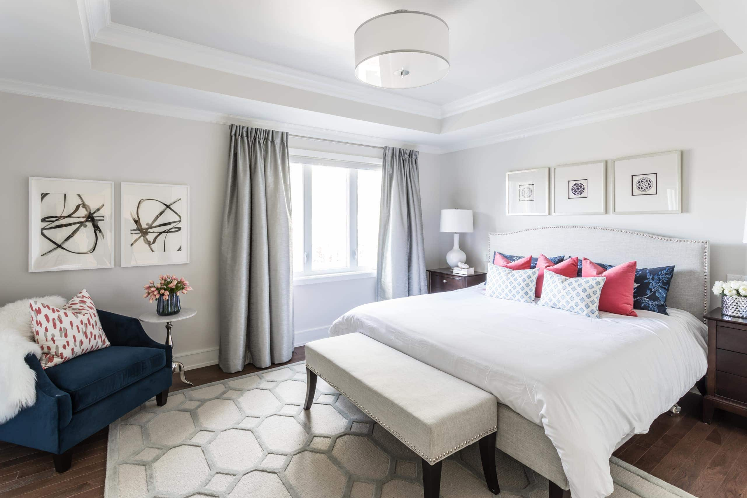 Large, white master bedroom with a white and gray carpet