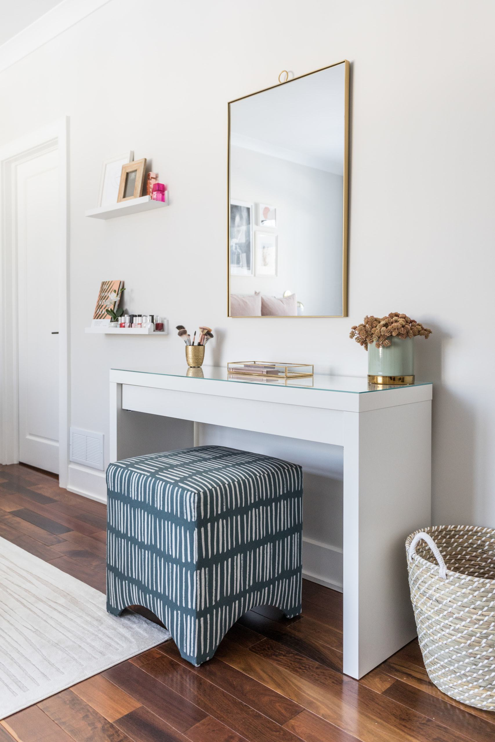 White table against the wall with various decorations on it