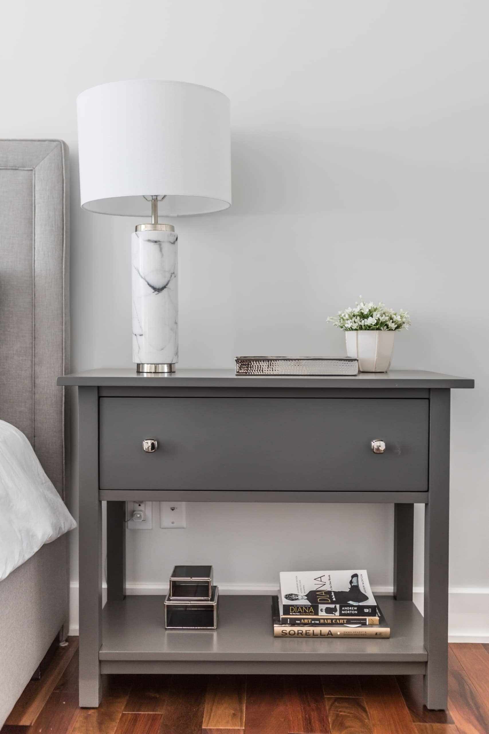 Dark bedside table next to the bed