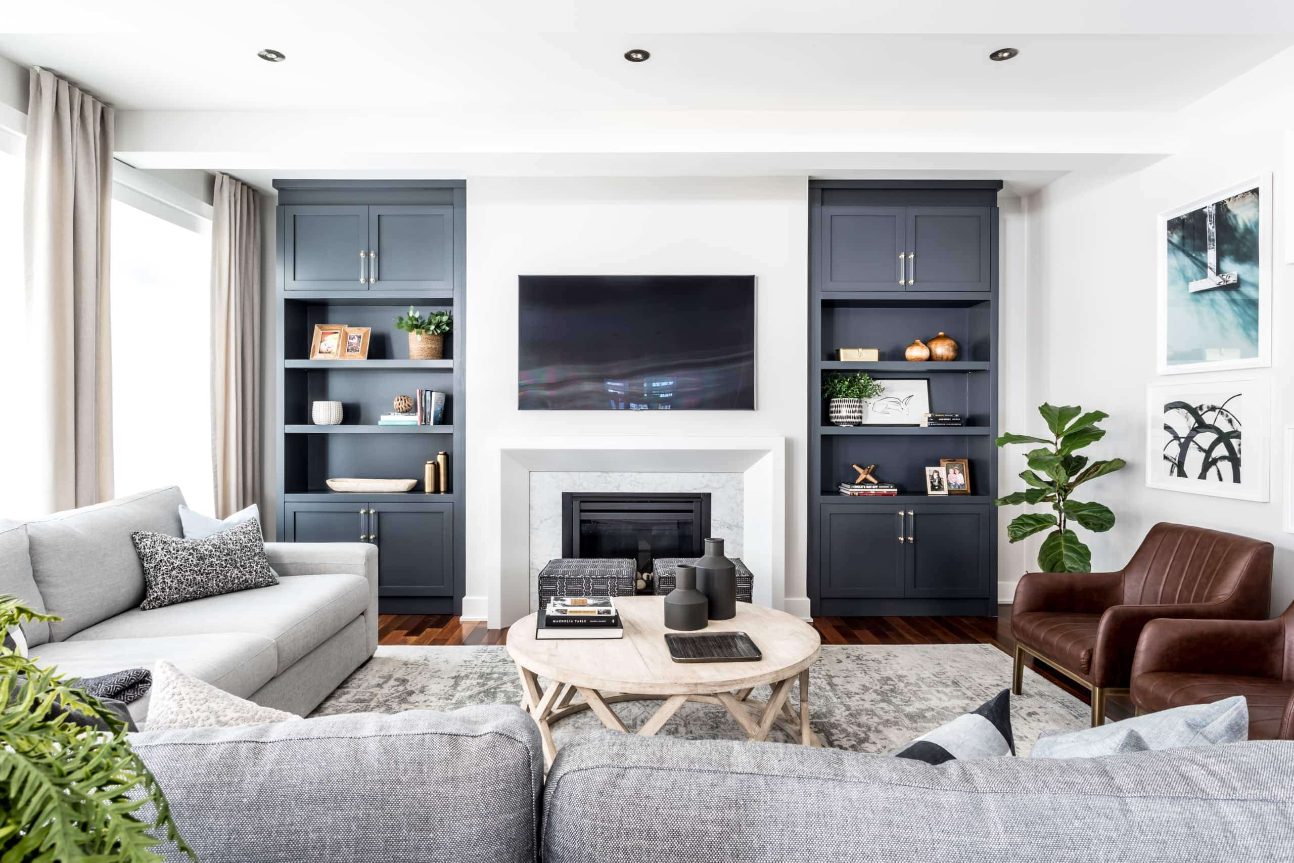 Two blue bookcases flanking the fireplace within the living room