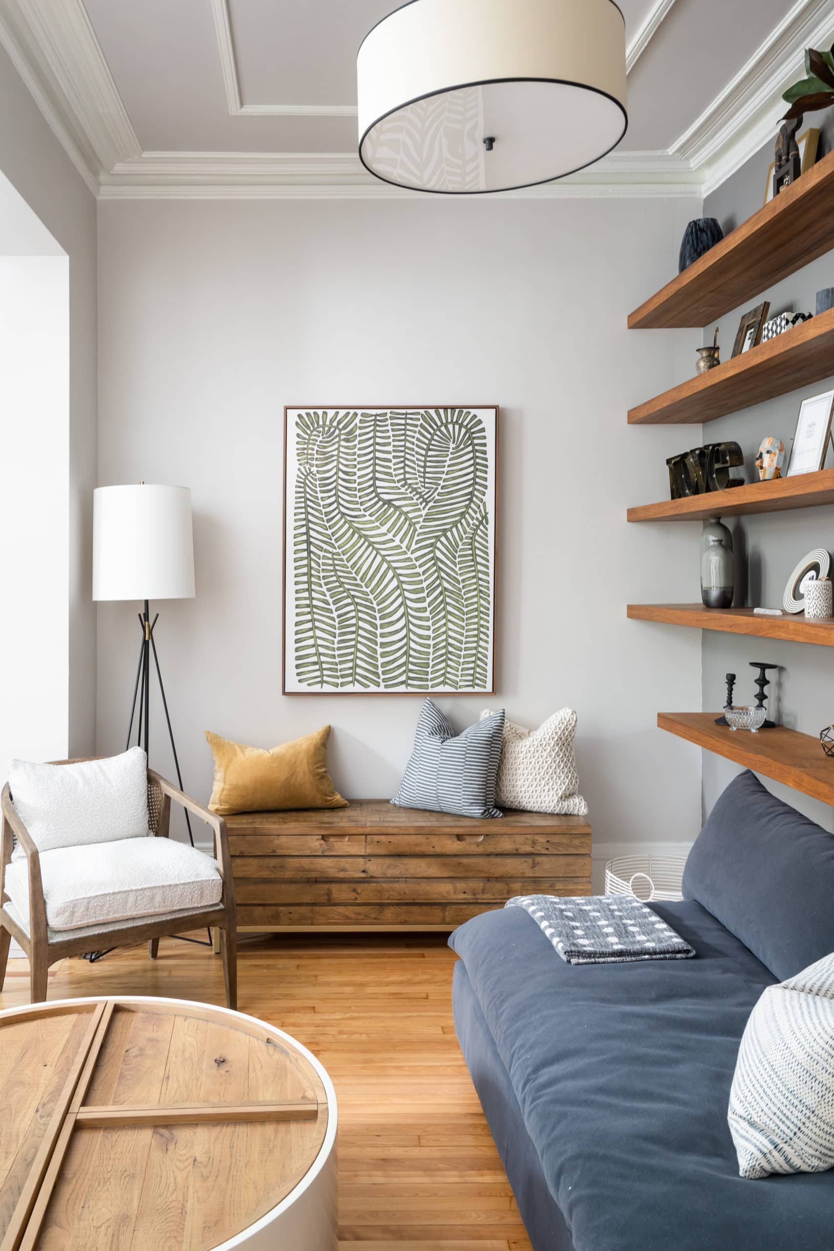 Small, cozy corner of a living with a small wooden bench