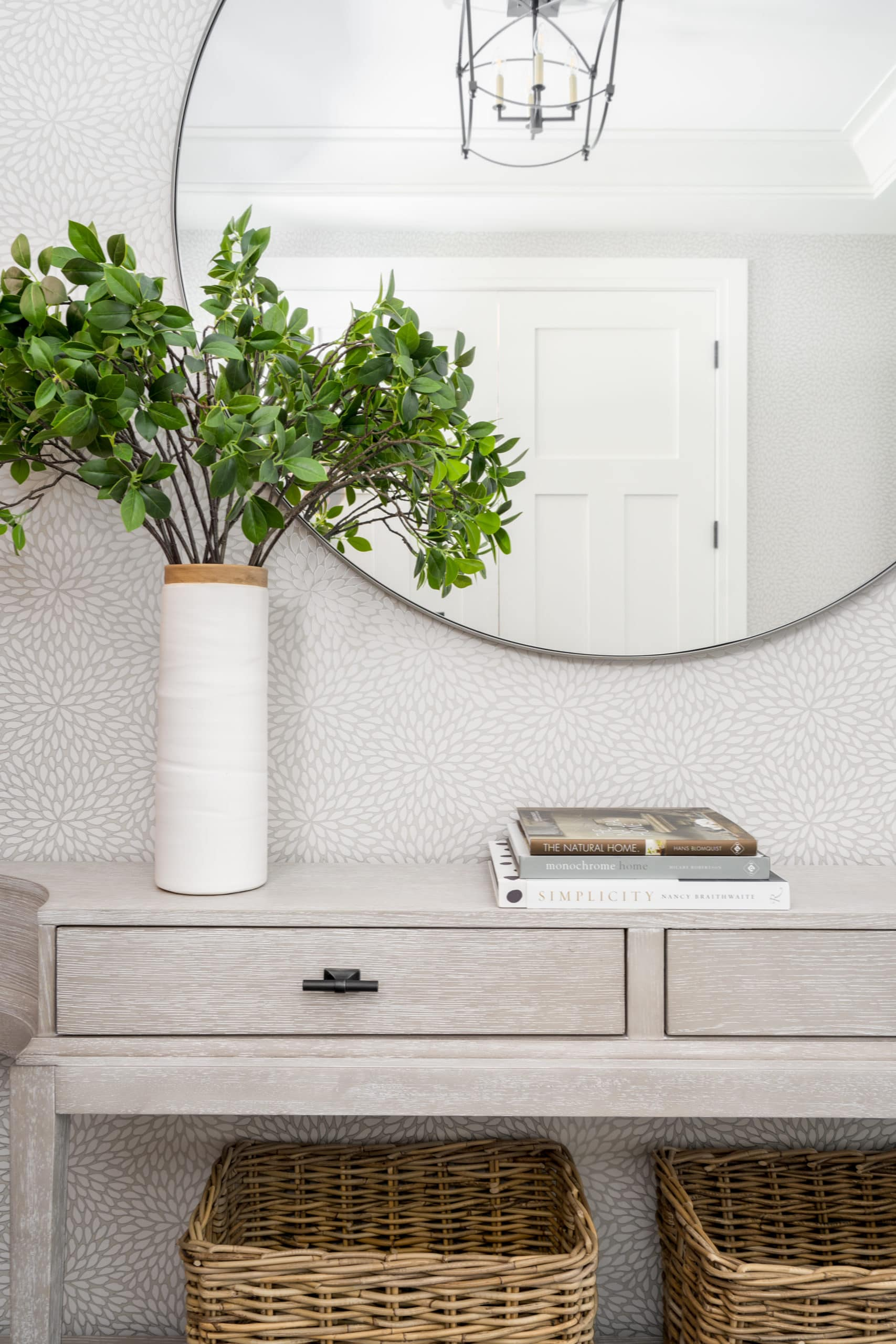 Modern gray table against the wall with a mirror above it
