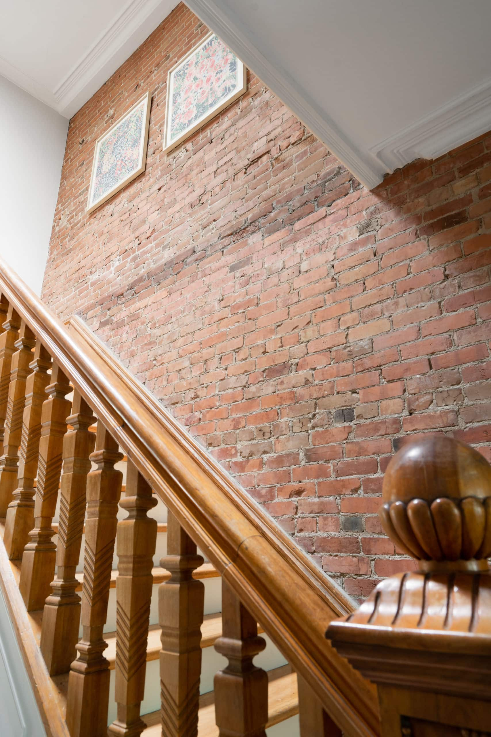 Staircase next to a brick wall