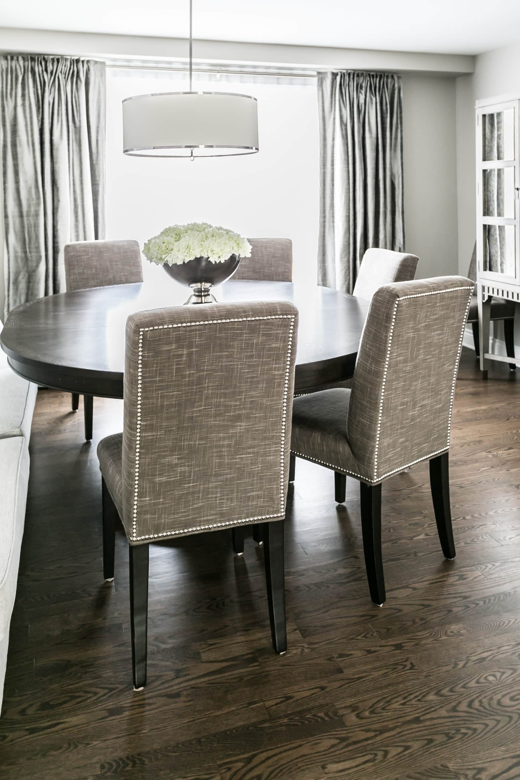 Modern dining room with a round wooden table