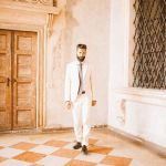 Groom wearing white suit at wedding in Italy, wedding style inspiration
