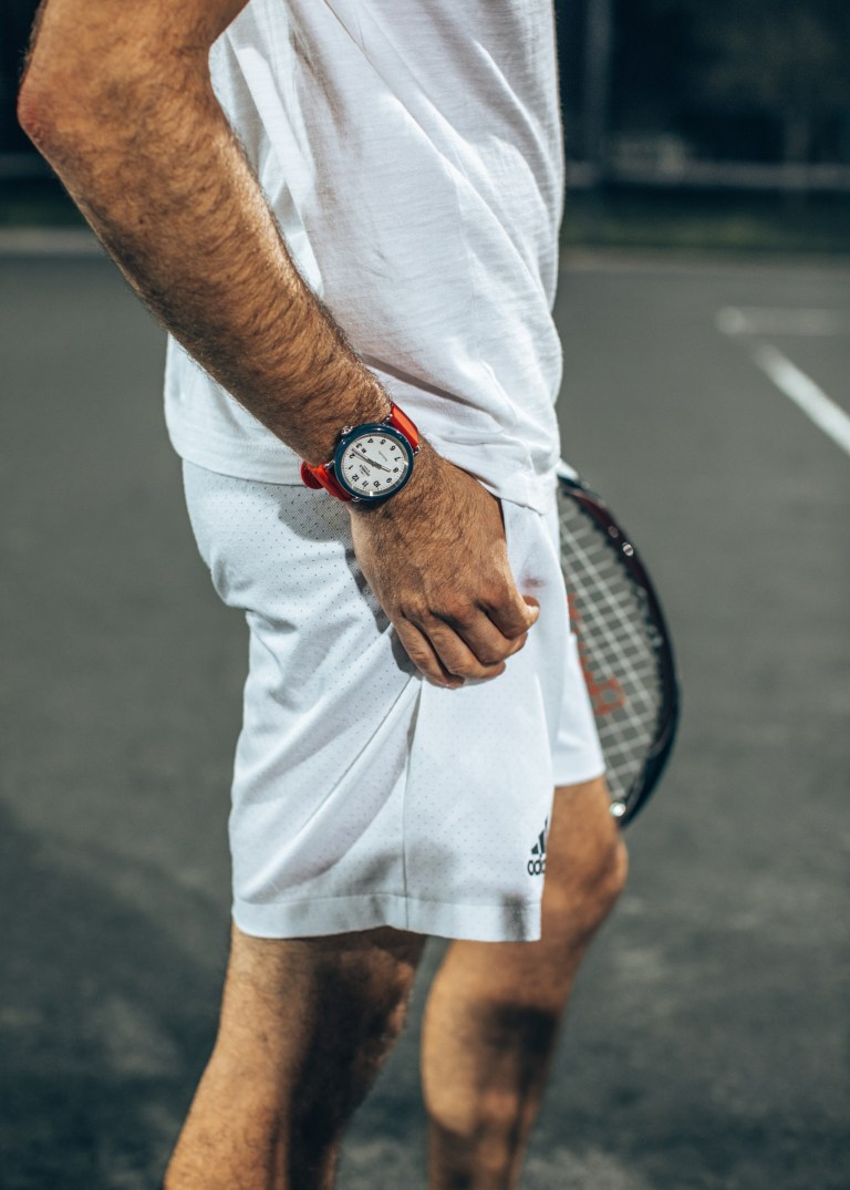Michael Checkers wearing a Shinola Detrola Ace watch on a tennis court in Miami