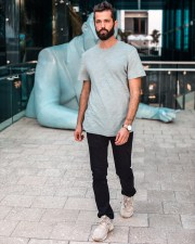 Street style photo of Michael Checkers wearing Deveruex proper theards in Miami Design District