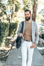 Michael Checkers Miami Beach street style photo white pants and light khaki jacket