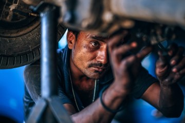 Mechanic Under Forklift